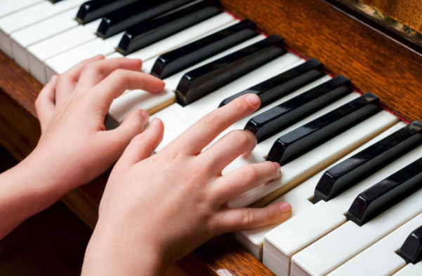 piano with hands playing